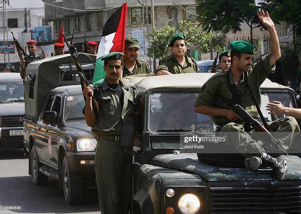 Palestinian security men patrol through the streets as they deploy to positions near the Rafah refugee camp border with Egypt on August 13 2005 in...