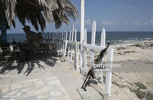 Palestinian security men sit near the beach by the Mediterranean Sea on the border between Egypt and Gaza in Rafah southern Gaza Strip on September...