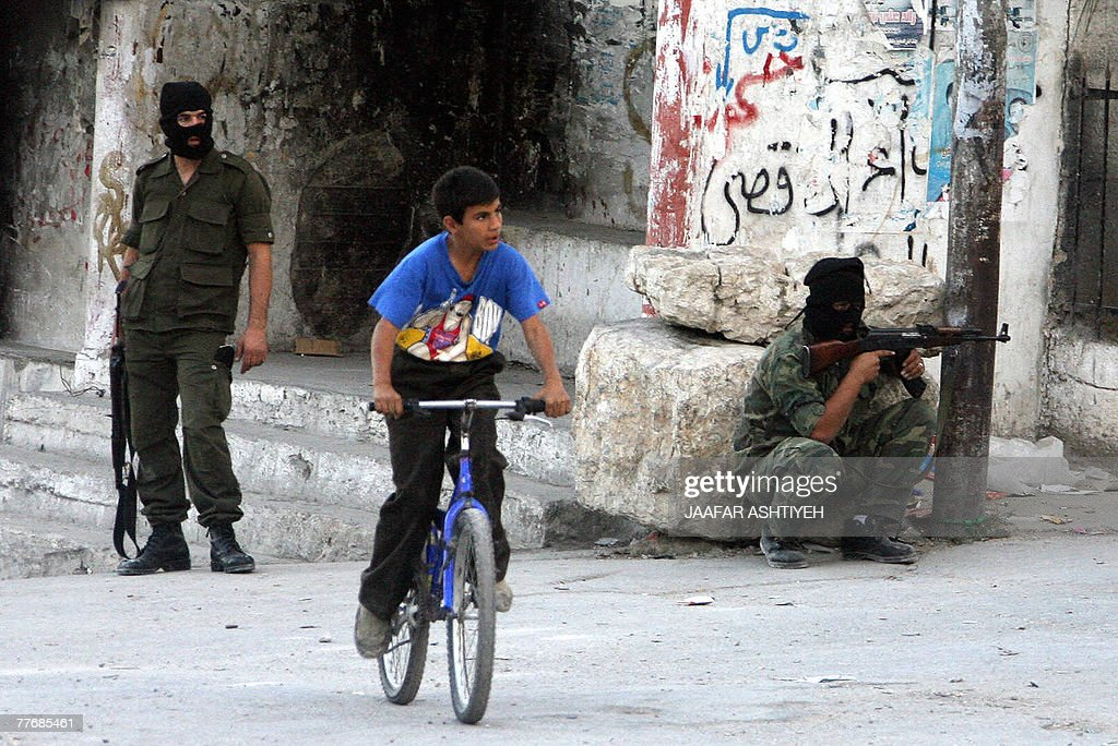 Palestinian security officers secure a street after fighting erupted when police arrested a man they mistakenly believed to be a member of the AlAqsa...