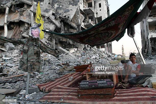 Palestinian sets up a scrappy tent as Palestinians get back to Beit Lahia to inspect their houses destroyed by Israeli army and collect their...