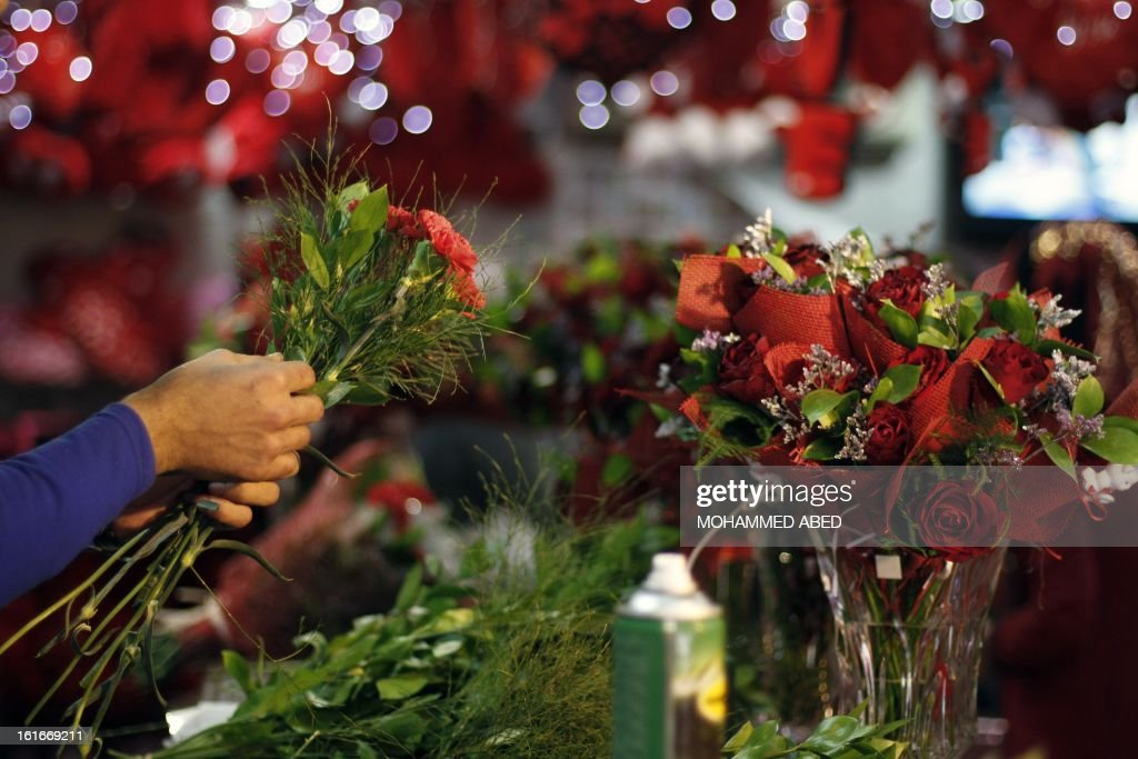 A Palestinian shopkeeper prepares bouquets at a flower market in Gaza City on Valentine's Day, on February 14, 2013. Valentine's Day is increasingly popular in the region as people have taken up the custom of giving flowers, cards, chocolates and gifts to sweethearts to celebrate the occasion. AFP PHOTO/MOHAMMED ABED