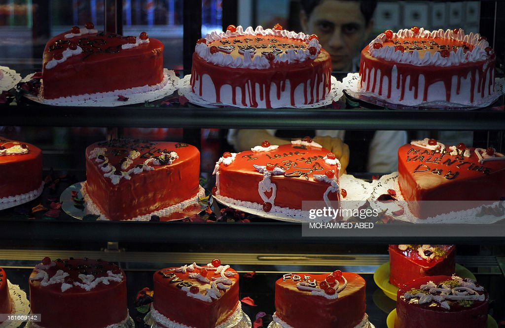 A Palestinian shopkeeper prepares heart shaped cakes on Valentine's Day in Gaza City on February 14, 2013. Valentine's Day is increasingly popular in the region as people have taken up the custom of giving flowers, cards, chocolates and gifts to sweethearts to celebrate the occasion. AFP PHOTO/MOHAMMED ABED