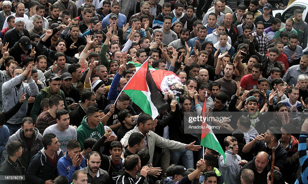 Palestinian shout slogans during the funeral of Anas al-Atrash, who was killed on November 7, 2013 by the Israeli army, in North Jerusalem. November 8, 2013, Hebron, West Bank.
