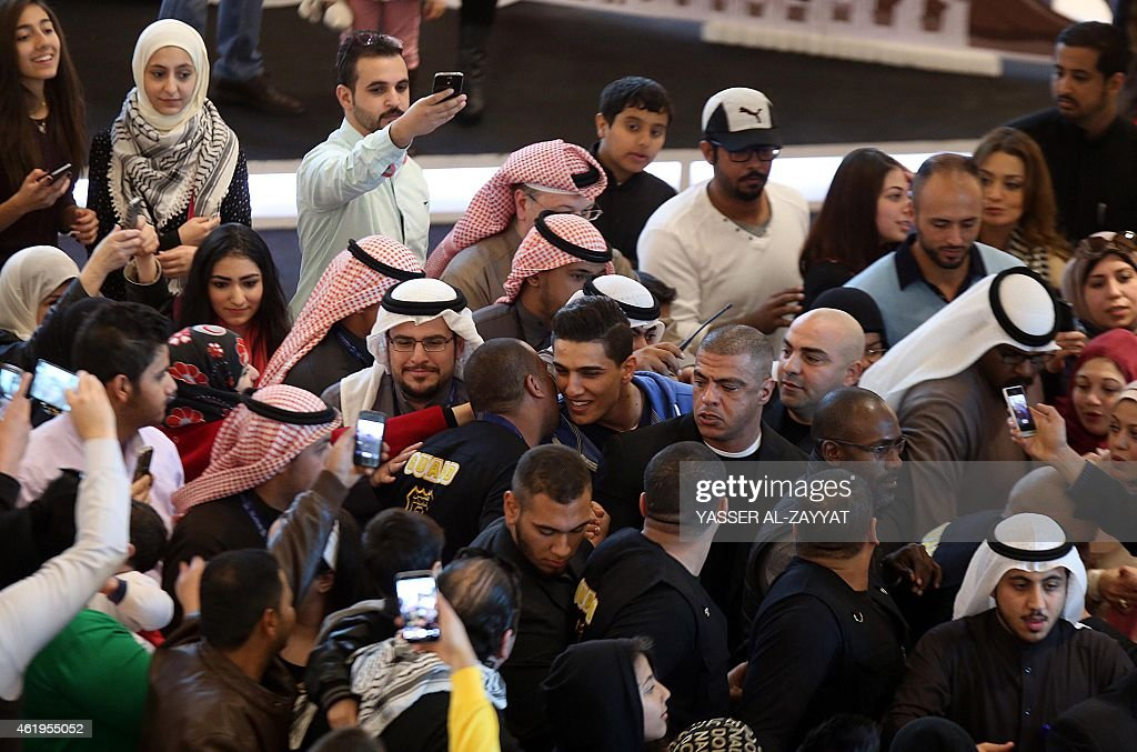 Palestinian singer <a gi-track='captionPersonalityLinkClicked' href=/galleries/search?phrase=Mohammed+Assaf&family=editorial&specificpeople=10886300 ng-click='$event.stopPropagation()'>Mohammed Assaf</a> (C) greets fans at the Gate Mall in Kuwait City, one of the country's largest malls, on January 22, 2015. Assaf is in Kuwait to participate in the Hala February festival concerts.
