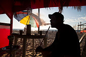 Palestinian smokes Shisha at Gaza beach Shisha a popular habit among youth Gazans shisha a water pipe used for smoking purposes originating about 500...