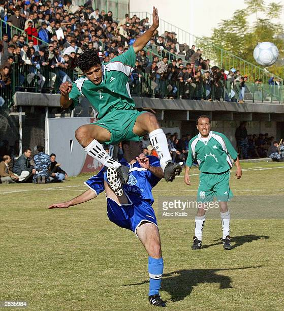 Palestinian soccer players fight for the ball during a soccer match December 29 2003 in Gaza City Gaza Strip This is the final game of the Gaza Cup...