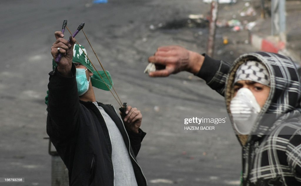 Palestinian stone throwers clash with Israeli border police in the West Bank city of Hebron on November 21, 2012, protesting against the ongoing Israeli military offensive on the Gaza Strip. Israel launched its offensive on November 14 with the targeted killing of a Hamas military chief. Since then, 147 Palestinians and five Israelis have been killed.