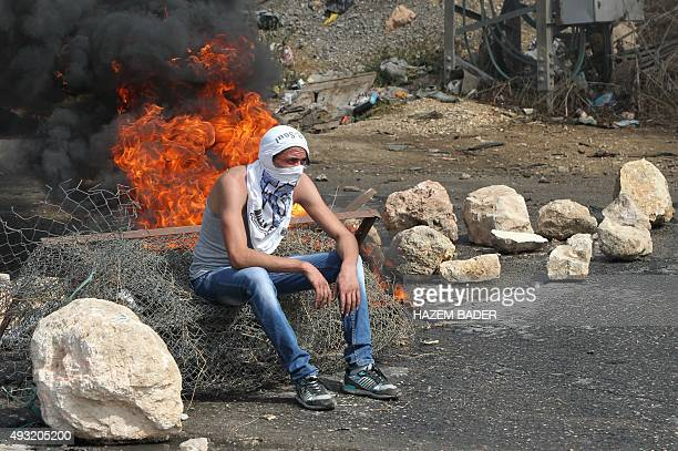 A Palestinian student from Palestine Polytechnic University sits during a protest against Israel near the Jewish settlement of Beit Hagai at the...