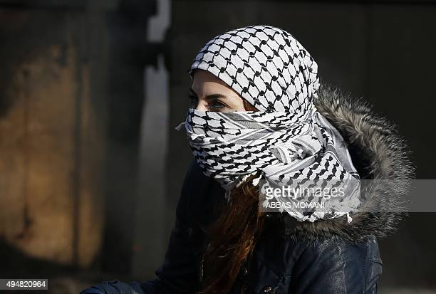 A Palestinian student from the Birzeit University joins stonethrowing protesters confronting Israeli troops at the northern entrance of the...