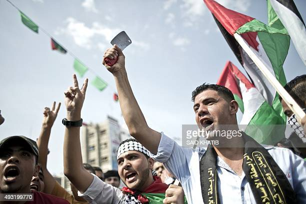 A Palestinian student holds a knife and shouts slogans during an antiIsrael protest in the city of Khan Yunis in the Southern Gaza Strip on October...