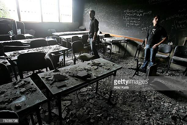 Palestinian students and visitors inspect the damaged and burnt laboratories and classrooms of The Islamic University a scientific stronghold of...