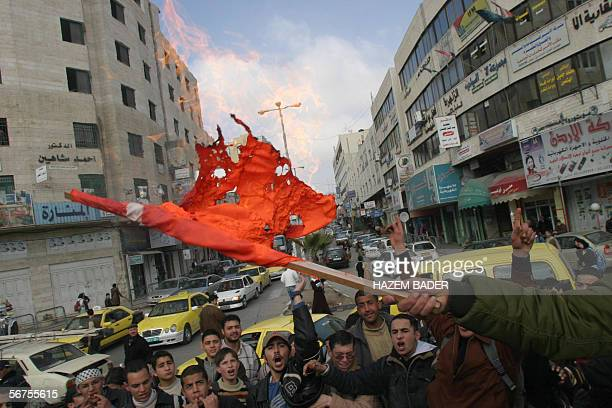Palestinian students burn a makeshift Danish as a protest against the publication of cartoons depicting Prophet Mohammed in Europe 06 February 2006...