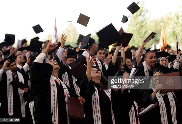Palestinian students celebrate during their graduation ceremony at Birzeit University near the West Bank city of Ramallah on June 5 as some 8500...