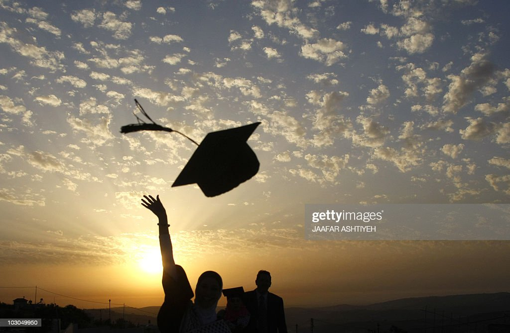 Palestinian students celebrate during their graduation ceremony at al-Najaf University near the northern West Bank city of Nablus on June 7, 2010, as some 2705 students received their degrees at the end of the 2009-2010 academic year.
