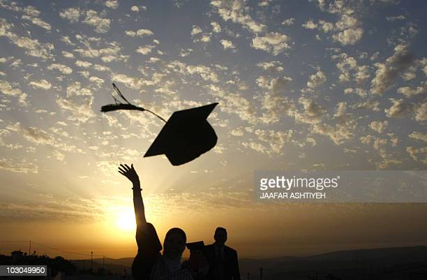 Palestinian students celebrate during their graduation ceremony at alNajaf University near the northern West Bank city of Nablus on June 7 as some...