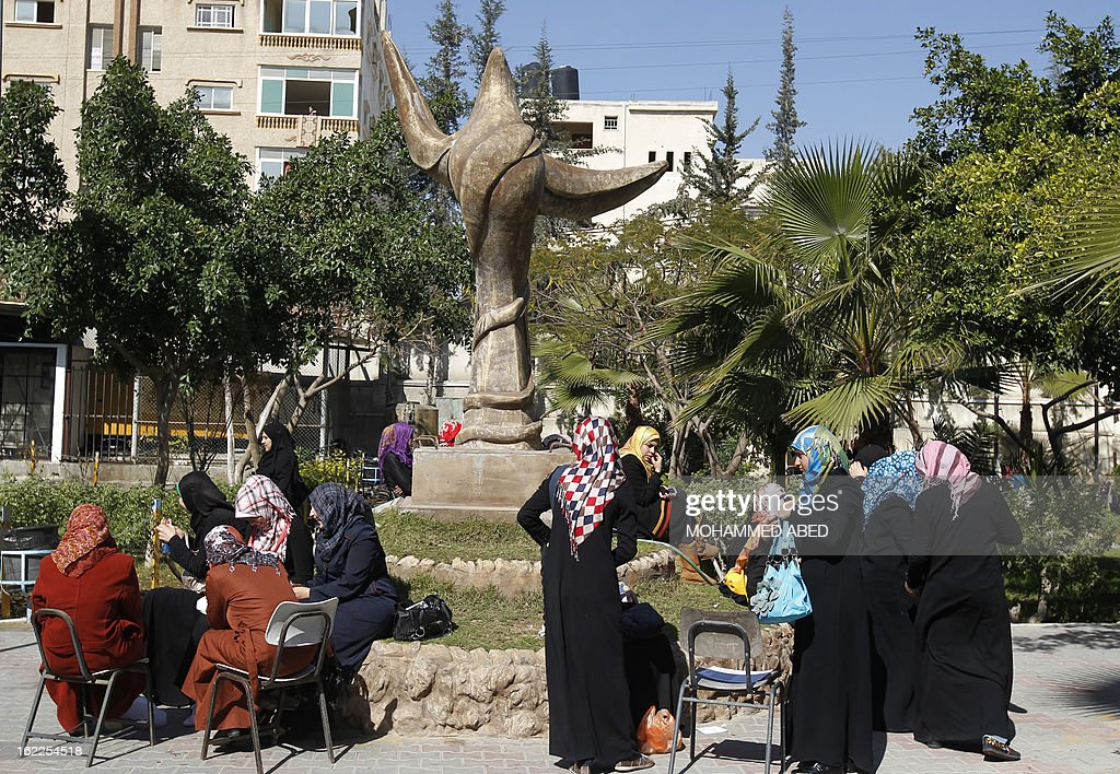 Palestinian students gather in the campus of Al-Aqsa University in Gaza City on February 21, 2013. The university has denied reports that it has decided to impose a 'strict' Islamic dress code on female students. AFP PHOTO/MOHAMMED ABED