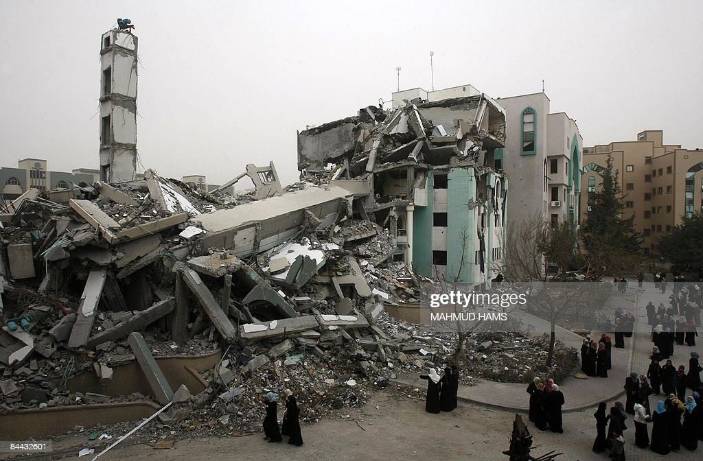 Palestinian students gather near the rubble of the Islamic university which was destroyed during Israel's 22day offensive in Gaza City on January 24...