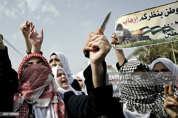Palestinian students hold a knife during an antiIsrael protest in the city of Khan Yunis in the Southern Gaza Strip on October 18 2015 Israel pressed...