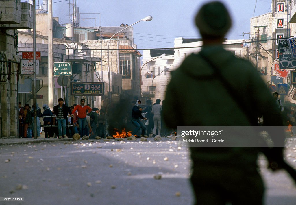 Palestinian students riot and set fires in the street. Military officers arrested some of the students during the protest.