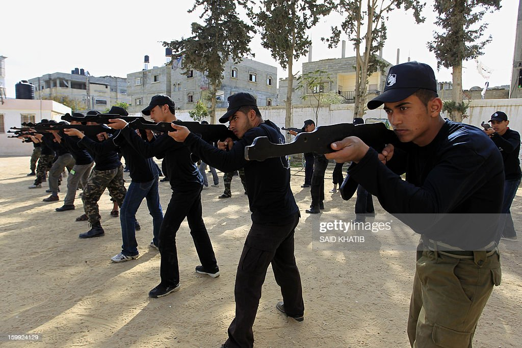Palestinian students take part in a training session organised by Hamas national security in the southern Gaza Strip city of Rafah on January 23, 2013. Israel's elections, which saw an even split between rightwing and centre-left blocs, are unlikely to produce a coalition bent on reviving peace talks, a Palestinian official said. AFP PHOTO/SAID KHATIB