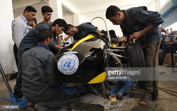 Palestinian students work on their Formula 1style racing car made from scratch out of recycled parts they have produced at their technical college...