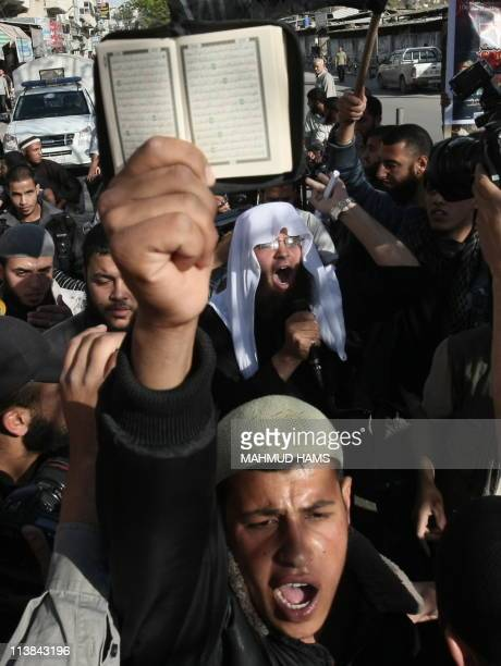 A Palestinian Sunni Muslim fundamentalist hold up a copy of the Koran during a protest in Gaza city on May 7 denouncing the US Navy SEALs operation...