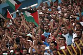 Palestinian supporters encourage their team during the 2018 FIFA World Cup qualifying football match between Palestine and UAE at the Faisal...