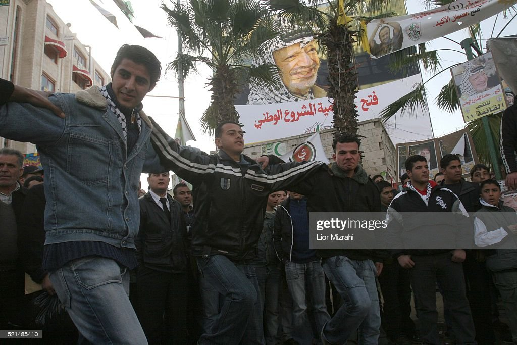Palestinian supporters of Fatah dance in Manara roundabout in the West Bank city of Ramallah Monday January 23 2006 The Palestinian legislative...