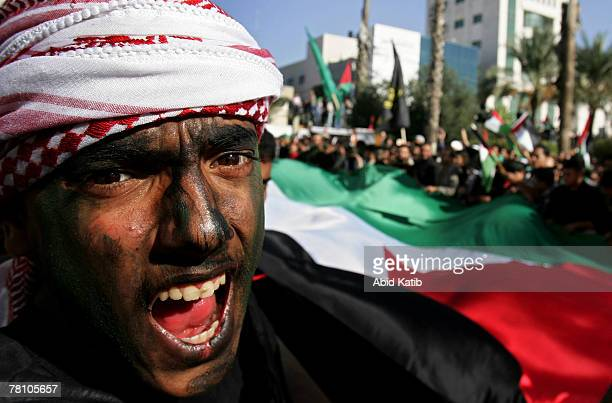 Palestinian supporters of Hamas and Islamic Jihad movements wave the Palestinian Flag and shout slogans as they protest against this week's Middle...