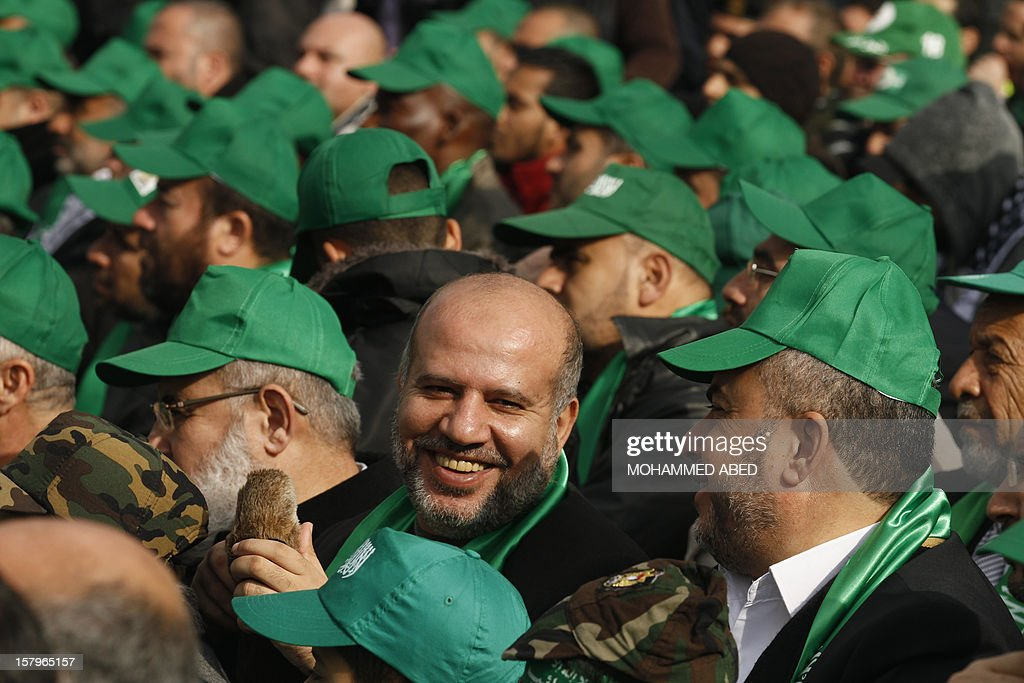 Palestinian supporters of Hamas wear green hats during a rally in Gaza City on December 8, 2012, to mark the 25th anniversary of the founding of the Islamist movement. More than 100,000 Palestinians gathered in Gaza for the rally to mark the occasion during which Hamas leader in exile Khaled Meshaal delivered a speech. AFP PHOTO/MOHAMMED ABED