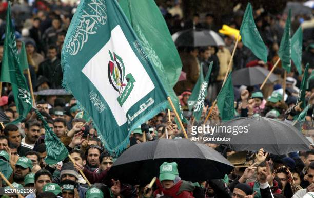 Palestinian supporters of Hamas winners of the Palestinian elections wave green Islamic flags following Friday noon prayers at The 'Dome of the Rock'...