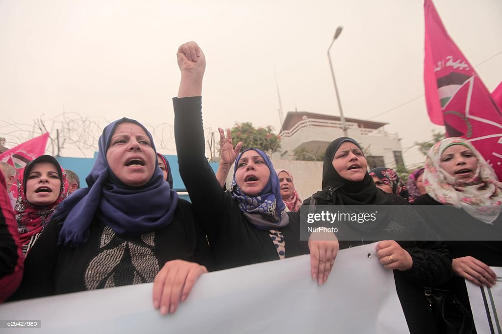 Palestinian supporters of the Democratic Front for the Liberation of Palestine during a demonstration in support of the Dawabsha family whose house...