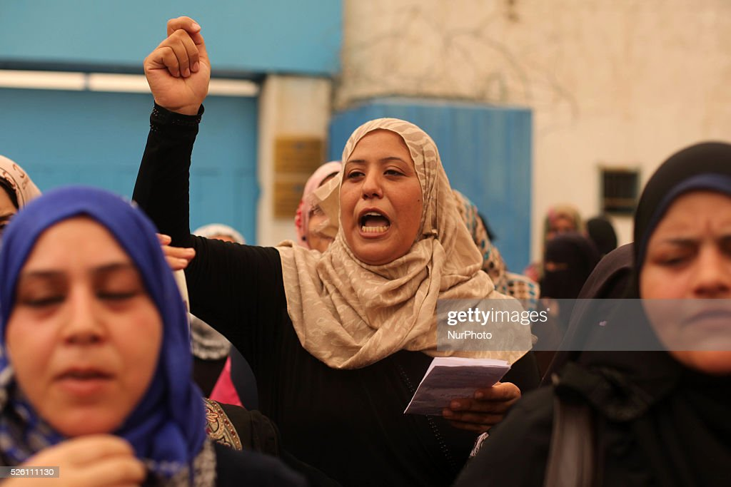 Palestinian supporters of the Democratic Front for the Liberation of Palestine chant slogans during a demonstration in support of the Dawabsha family...