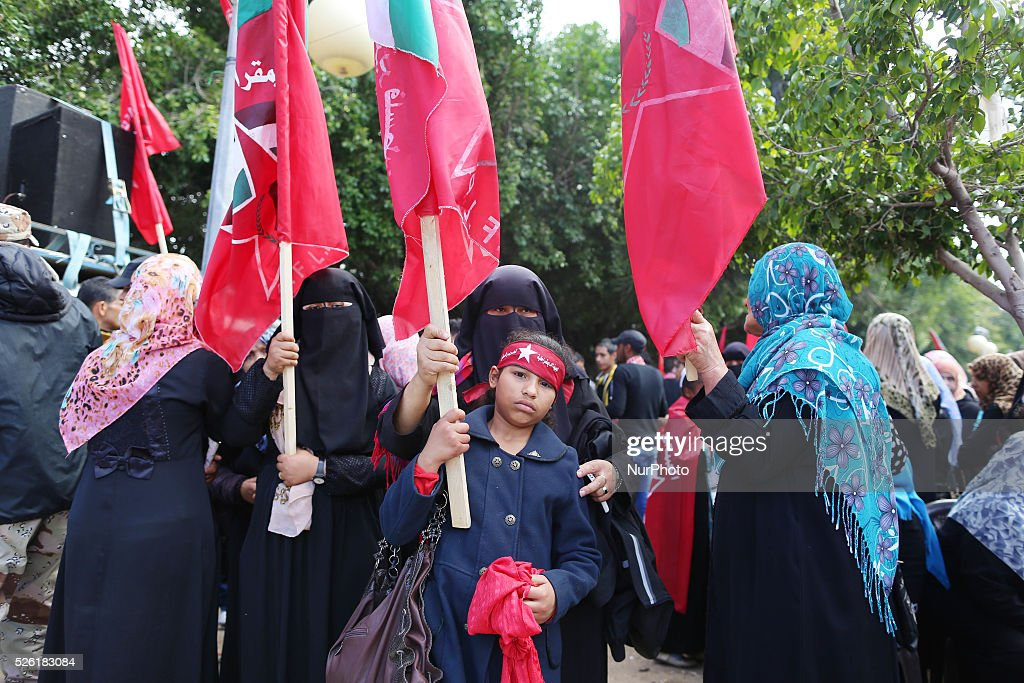 Palestinian supporters of the Democratic Front for the Liberation of Palestine shout slogans and hold flags of the movement during an antiIsrael...