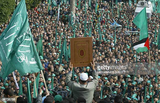 Palestinian supporters of the Islamic Hamas movement hold up copies the Koran during a demonstration in Gaza City 03 February 2006 against the...