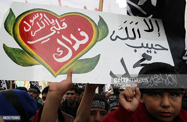 Palestinian supporters of the Islamists Tahrir Party wave black and white flags with the religous writing 'There is no God but God and Mohammed is...