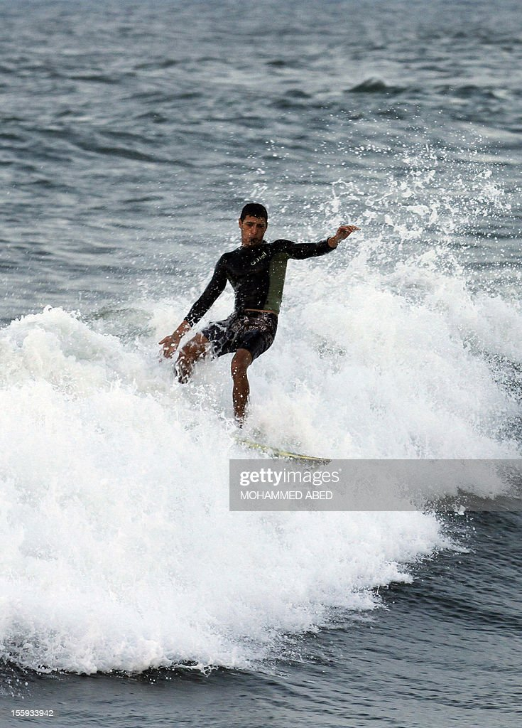 A Palestinian surfer rides a wave off the coast of the Gaza Strip in the Mediterranean Sea on November 9, 2012. Life in the poor and crowded Gaza Strip is going to get harsher still unless action is taken now, according to a new United Nations report.
