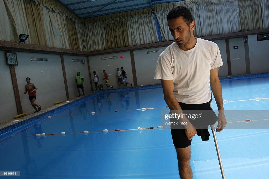 Palestinian swimmer Shahdi elMasry rests after warmingup before training at the Nama'a Sports Club on March 30 in Jabaliya Gaza Strip Shahdi's leg...