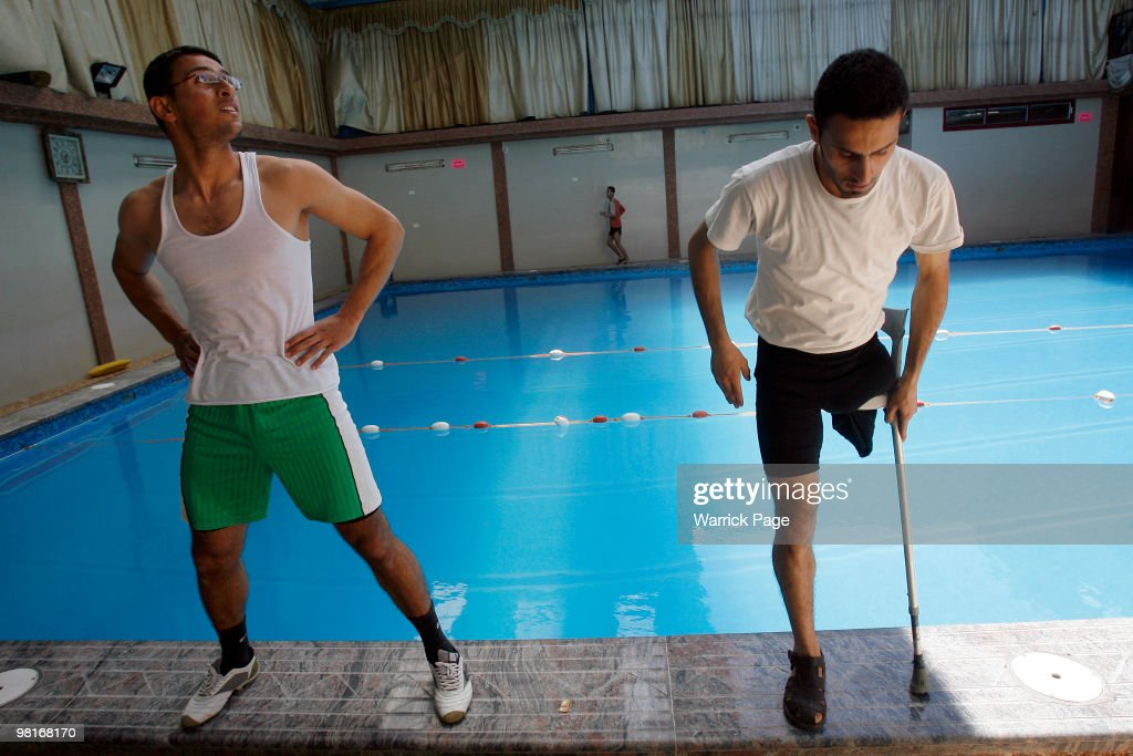 Palestinian swimmers Abdul Rahman and Shahdi elMasry perform warmup stretches before training at the Nama'a Sports Club on March 30 in Jabaliya Gaza...