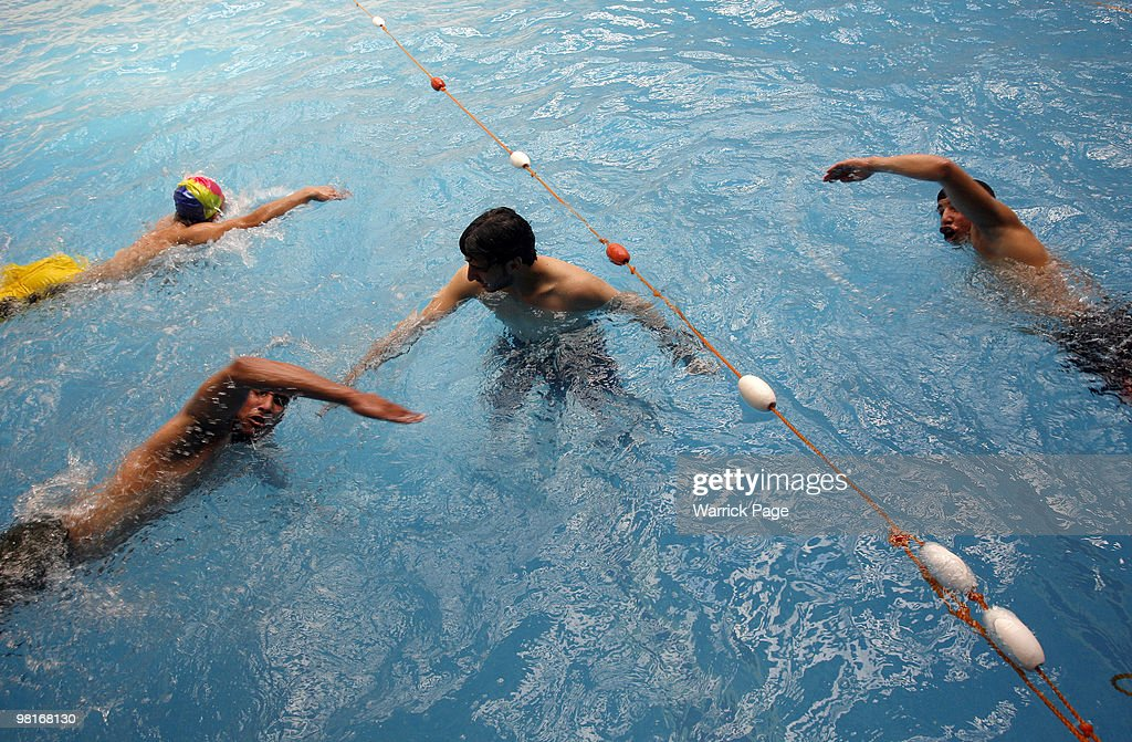 Palestinian swimming team practice their breathing and arm technique at the Nama'a Sports Club on March 28 in Jabaliya Gaza Strip Four Palestinian...
