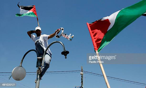 Palestinian takes part in a rally ahead of the 66th anniversary of Nakba in Rafah in the southern Gaza Strip Palestinians will mark 'Nakba' on May 15...