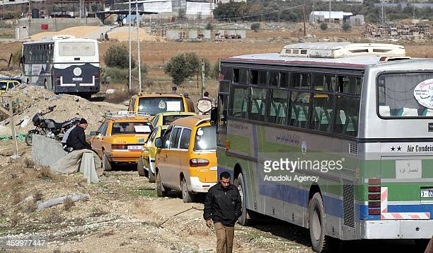 Palestinian taxi drivers stop their cars during a protest to solve the crisis of fuel in front of the Karni Crossing in the eastern Gaza city on...