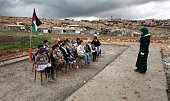 A Palestinian teacher leads a class of Palestinian bedouin children from the Abu Nawar community near the Jewish settlement of Maale Adumim in the...
