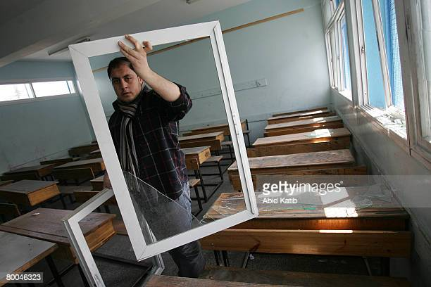 Palestinian teacher shows the damage at the UNRWA of Alshati primary school after Israeli aircraft attacked the neighbouring building belonging to...