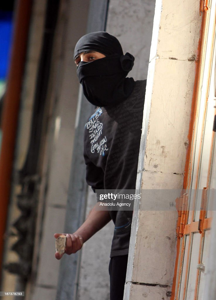 A Palestinian throws a stone during clashes with Israeli soldiers following the funeral of Anas al-Atrash, after he was killed by Israeli soldiers on November 7, 2013 in North Jerusalem. November 8, 2103, Hebron, West Bank.