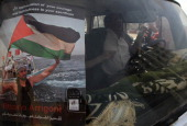 A Palestinian truck driver displays a picture of Italian activist Vittorio Arrigoni on his windshield in Gaza City as Gazans marked on April 14 2012...