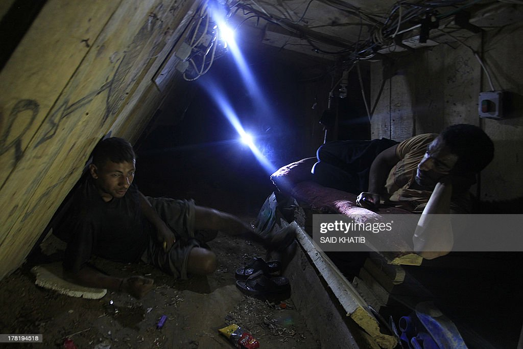 Palestinian tunnel workers rest inside a smuggling tunnel dug beneath the Gaza-Egypt border in the southern Gaza Strip on August 27, 2013. Egyptian security forces have stepped up a crackdown campaign on smuggling tunnels between Egypt and the Gaza Strip since July, Hamas officials said.