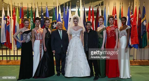 Palestinian UN Ambassador Riyad Mansour and Palestinianborn Italian fashion designer Jamal Taslaq pose for photographers at the end of Taslaq's...
