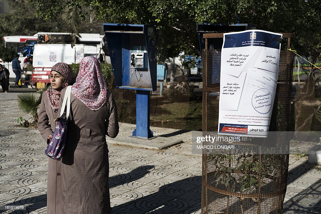 Palestinian university student from Gaza City wait to register to vote at an electoral commission station on February 12, 2013. Palestinian electoral officials began the long-overdue process of updating voter rolls in the West Bank and Gaza in a vital step towards eventual elections.
