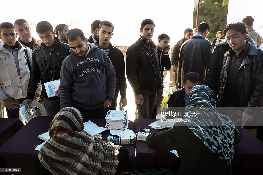 Palestinian university students from Gaza City register to vote at an electoral commission station on February 12, 2013. Palestinian electoral officials began the long-overdue process of updating voter rolls in the West Bank and Gaza in a vital step towards eventual elections. AFP PHOTO/MARCO LONGARI